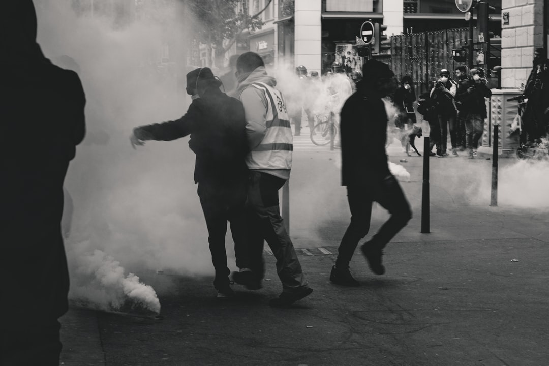 """Police fires tear gas at Yellow Vest demonstrators during the 25th weekend of protests in the streets of Lyon, France.  Police violence is at its highest since the 1950s. There is an extensive use of tear gas, sting-ball grenades and LBDs (""""defense ball launchers"""") against largely peaceful protestors. According to official numbers, as of now, 1.428  tear gas grenades and 13.460 rubber bullets have been fired. As of now (May 5th, 2019), 23 persons lost an eye and 5 persons their hand during protests (source: mediapart.fr, http://tiny.cc/6hd85y)."""