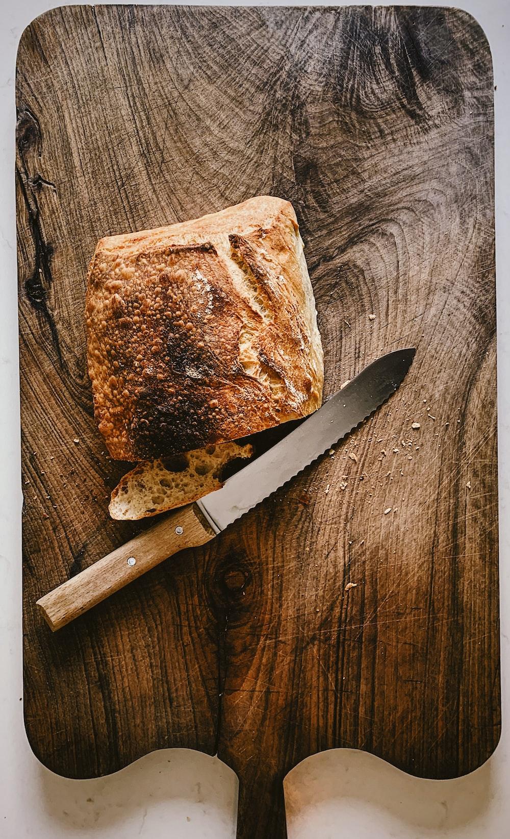 bread beside knife on chopping board