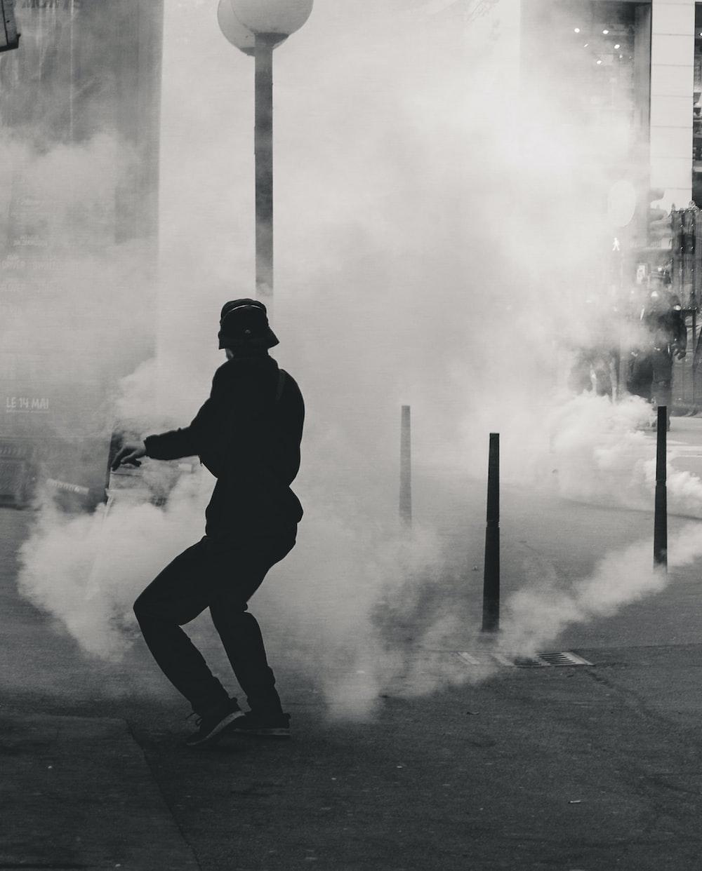 man standing near smoke