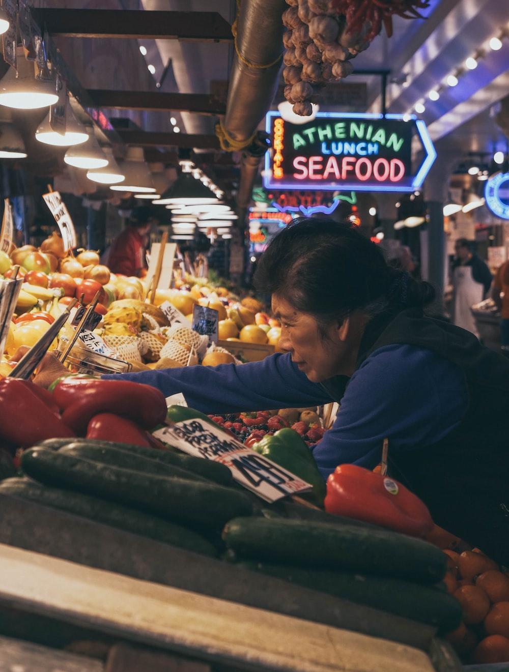 woman reaching vegetable