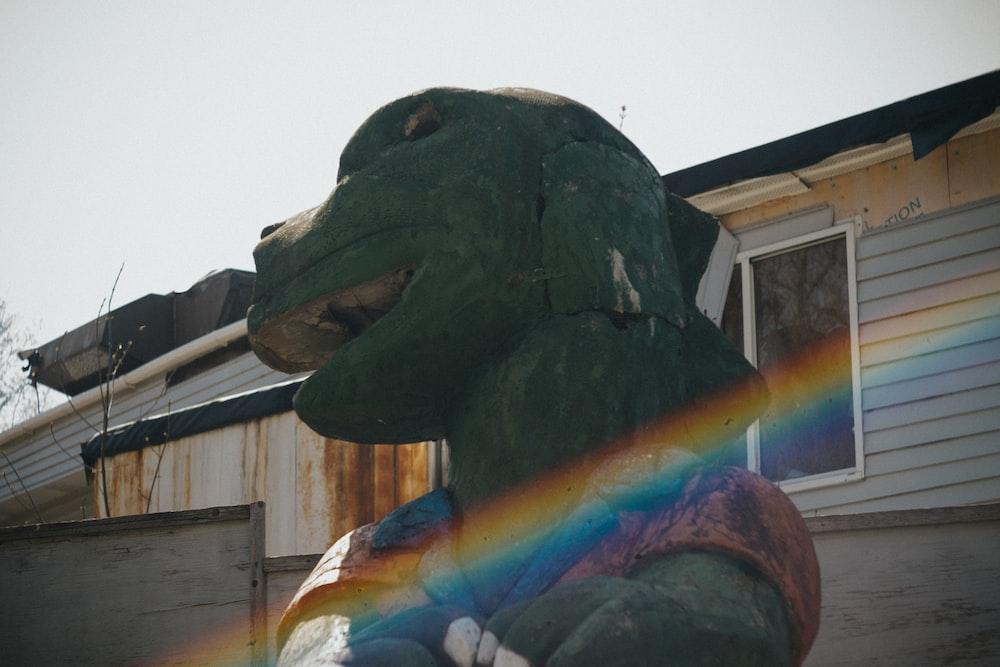 green dinosaur statue