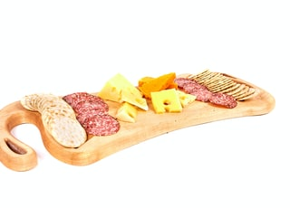 cheese and ham on chopping board