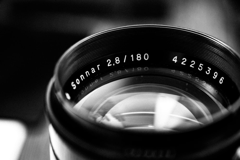grayscale photography of camera lens