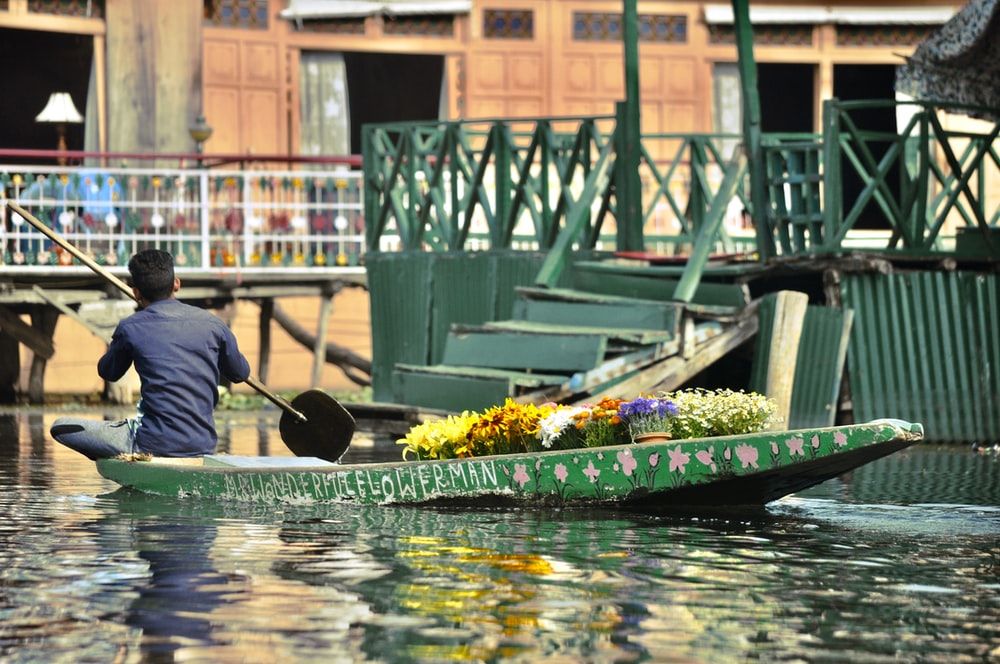 man on boat with flowers