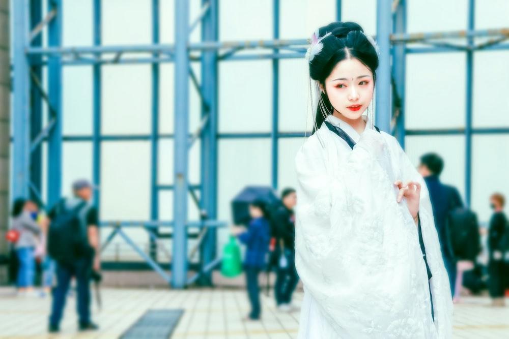 woman wearing white traditional dress