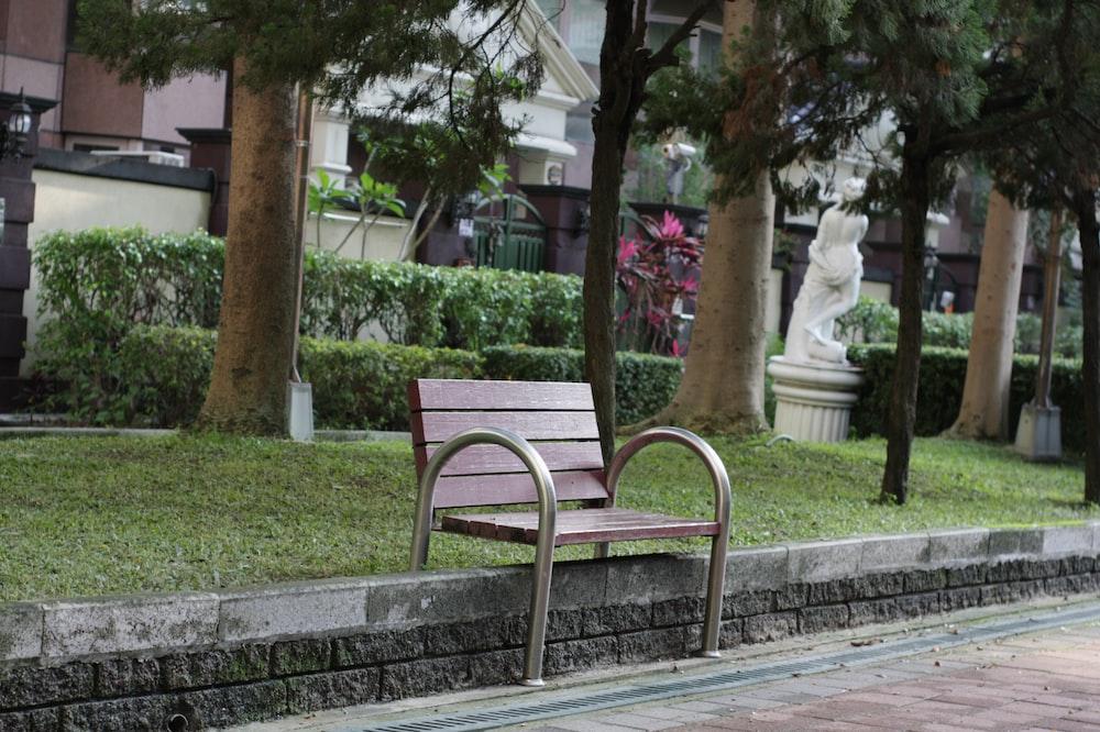 vacant brown armchair near green field