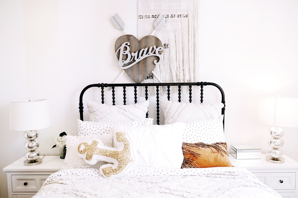 pillows on bed beside headboard