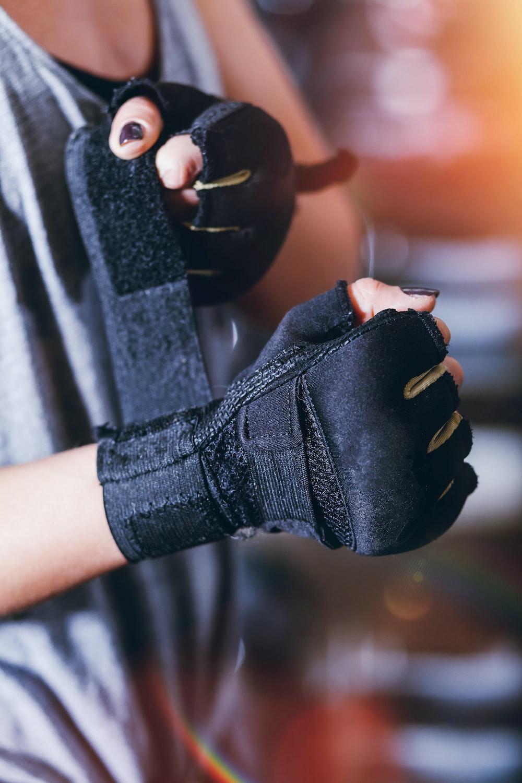 person wearing black fingerless gloves
