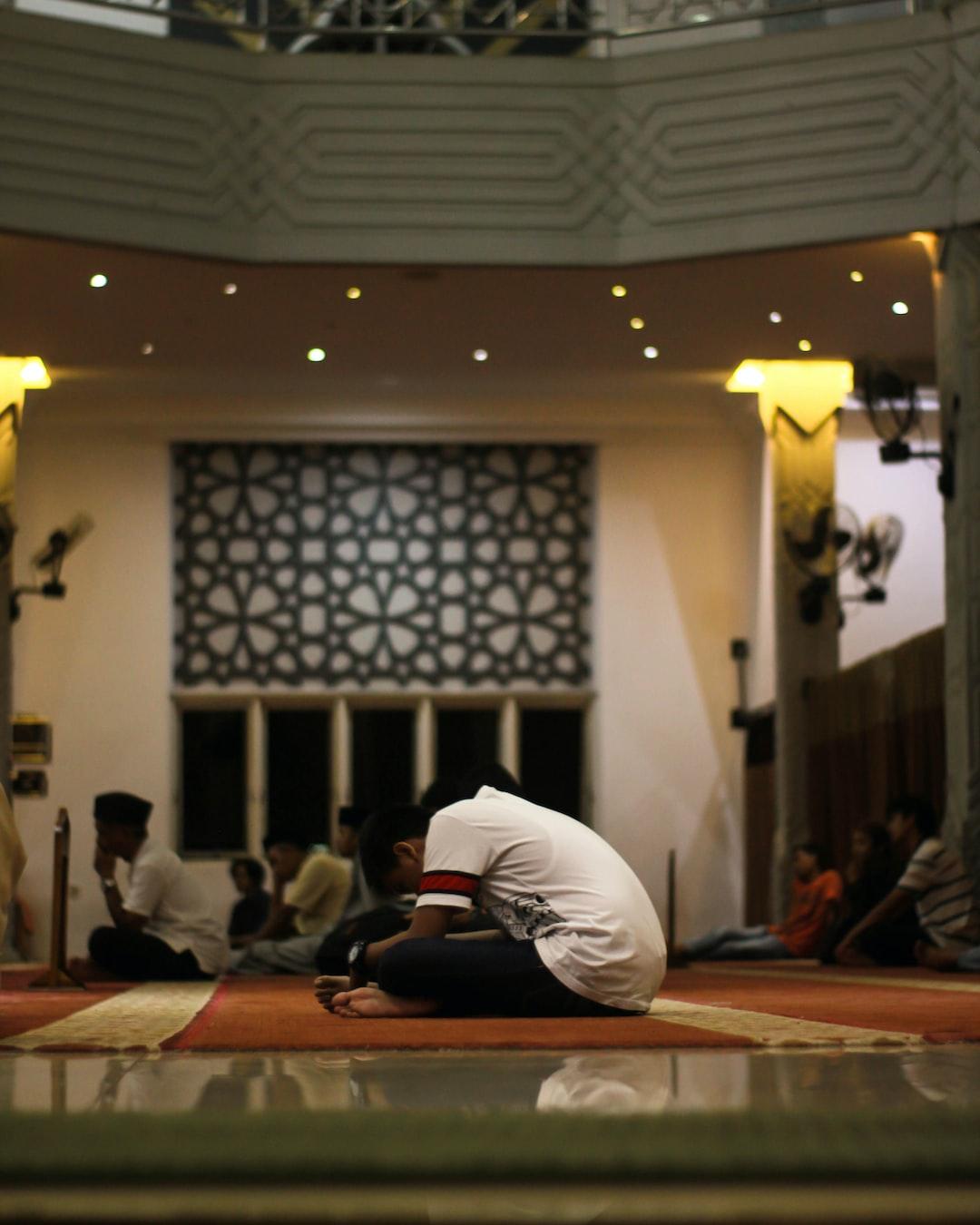 men sit in the mosque