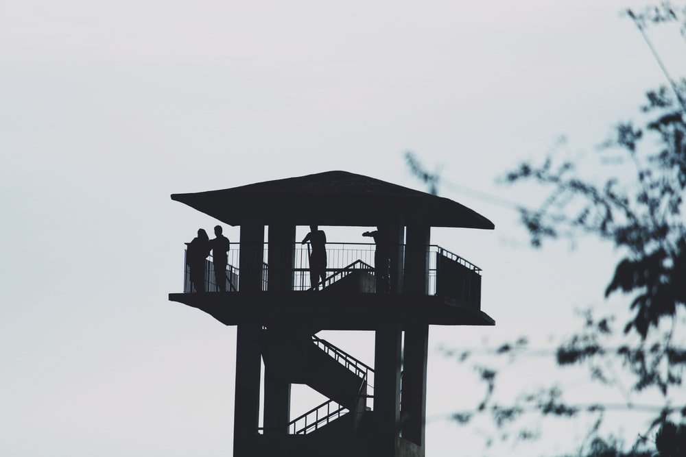 people in the watch tower at daytime