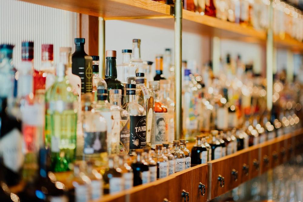 close-up photo of liquor bottles in rack