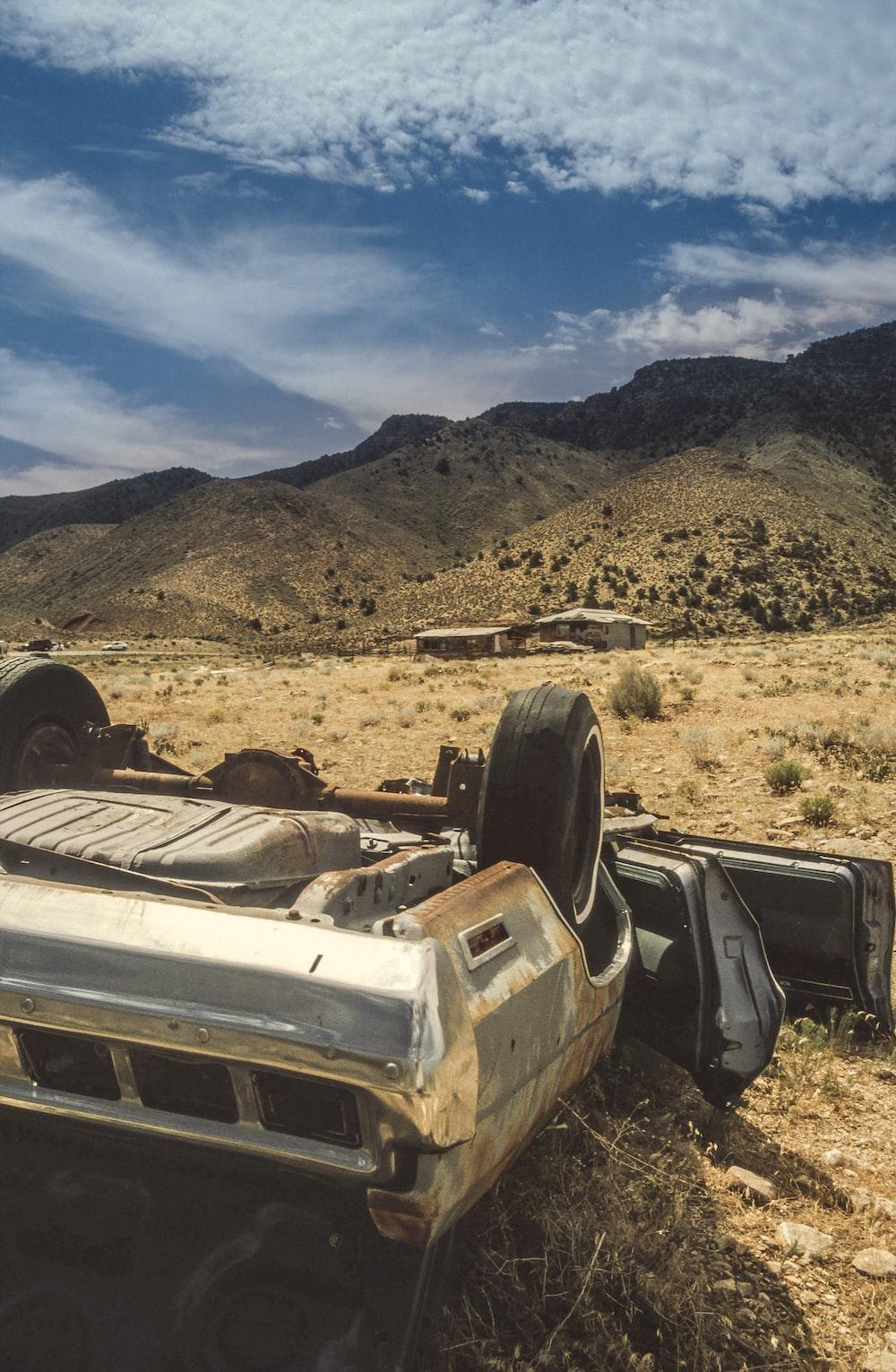 abandoned car on sand