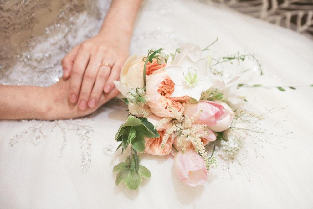 wedding bouquet on bride's lap
