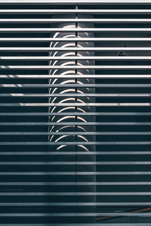 grey pillar behind railings