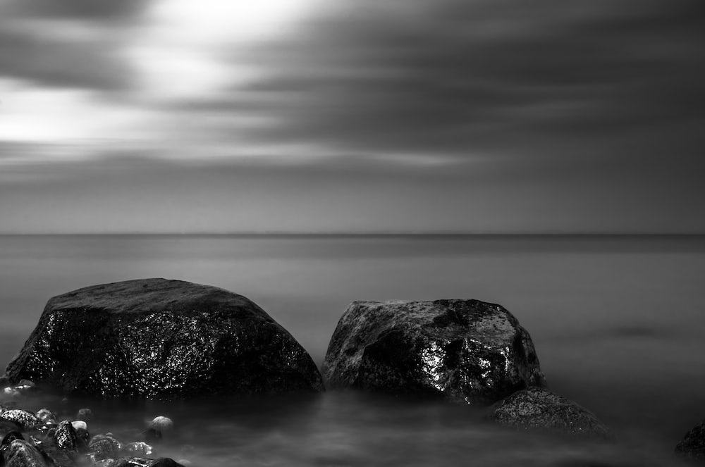 two rocks at the body of water