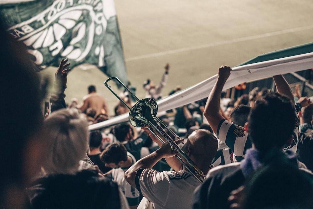 people cheering on stadium