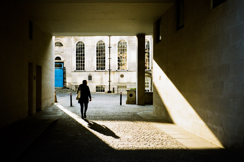 person walking near building during daytime