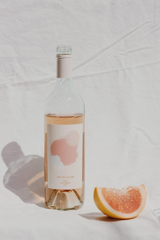 white labeled bottle and lemon