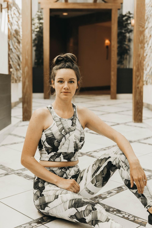 woman sitting on white pathway