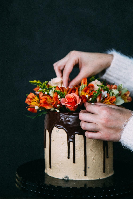 person decorating cake