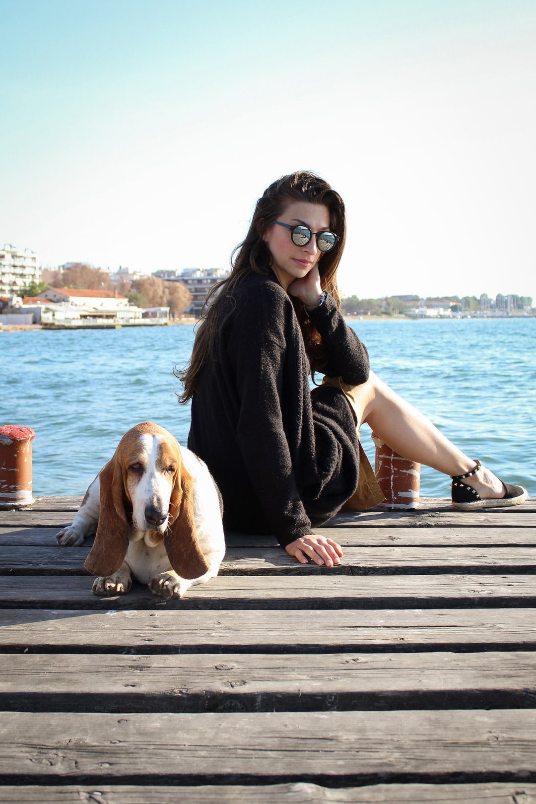 Female model realing with the her dog