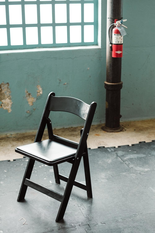 black wooden folding chair