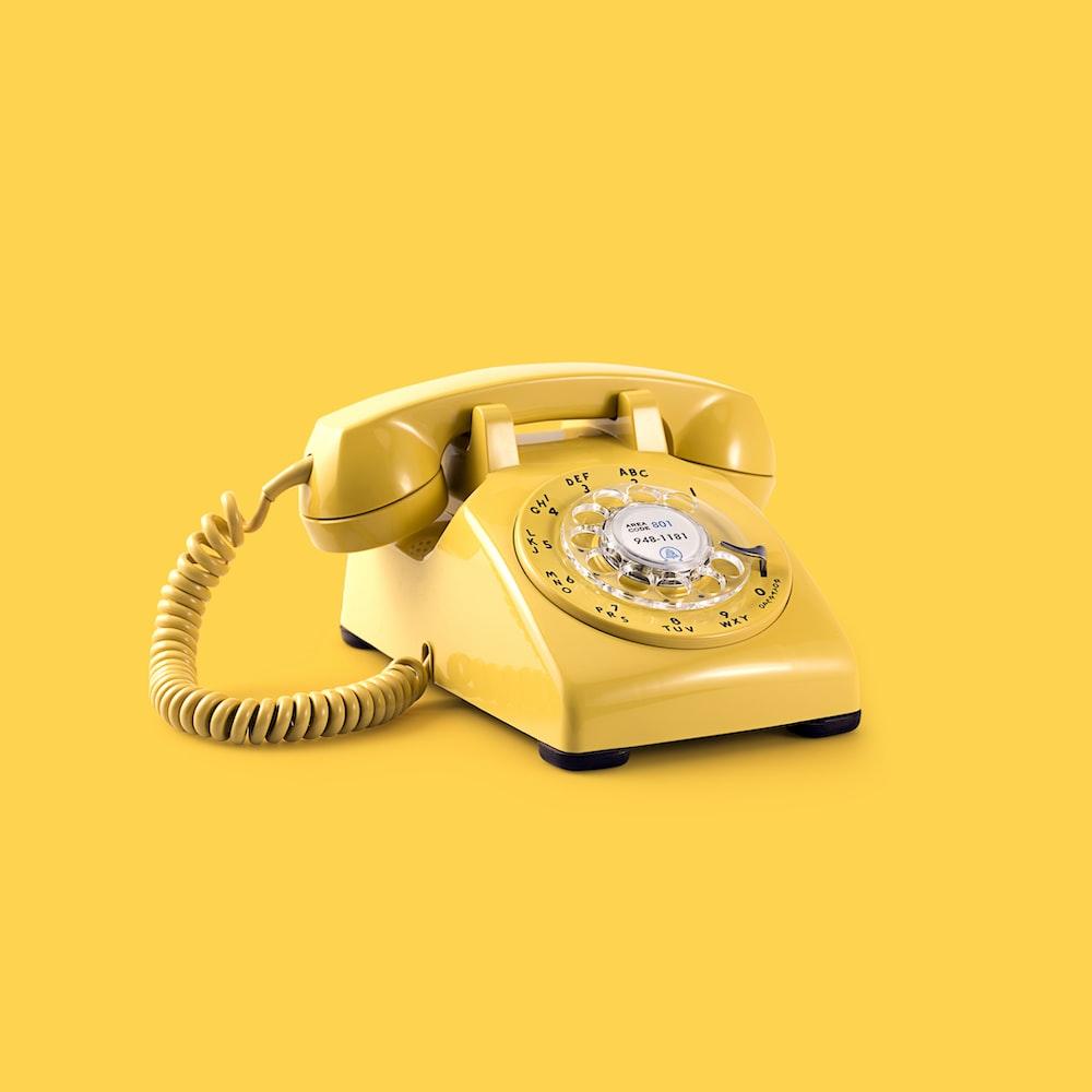 yellow rotary telephone