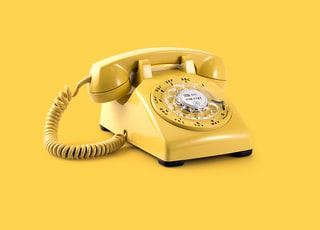 yellow rotary telephone