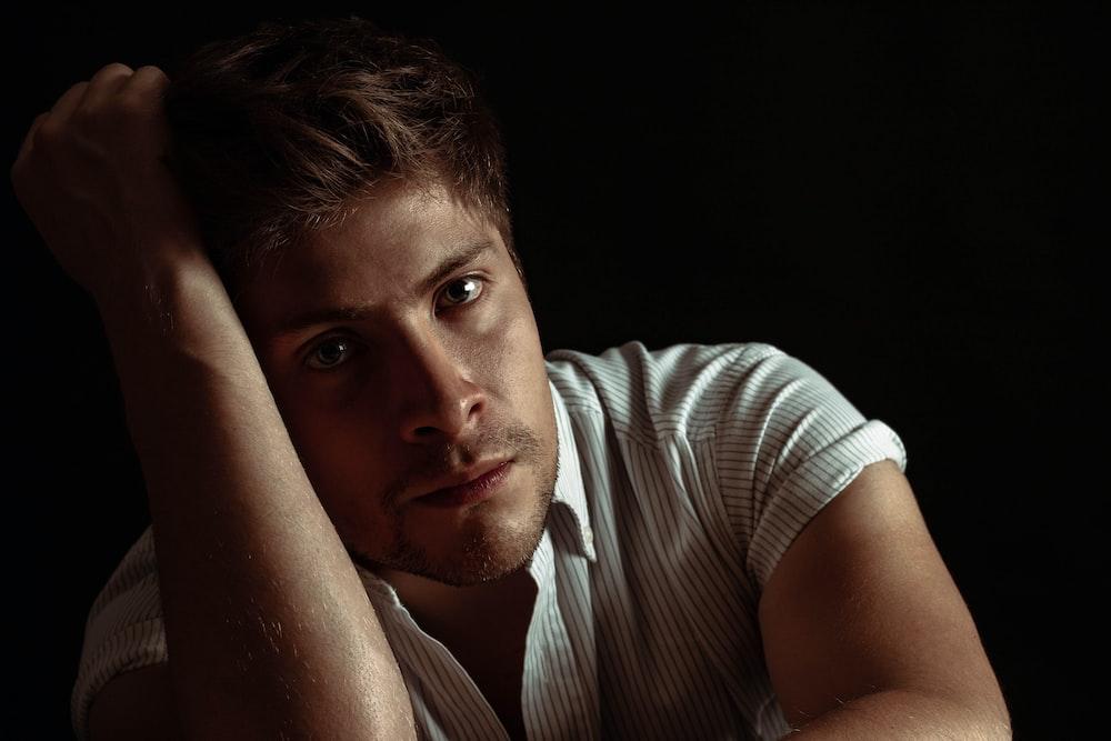 man wearing white and gray striped shirt