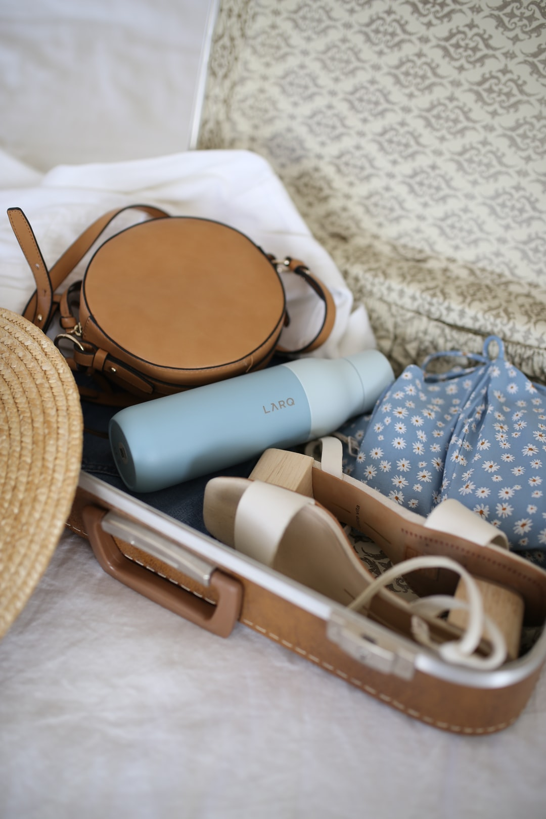 Summer travel essentials water bottle larq bottle packing for trip https://www.livelarq.com/water-bottle/