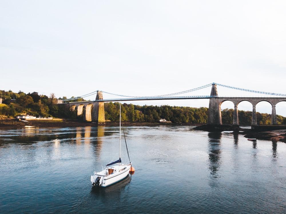 boat on water near bridge