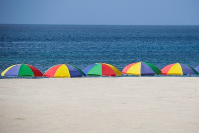 five parasols at the shore during day st. lucia teams background