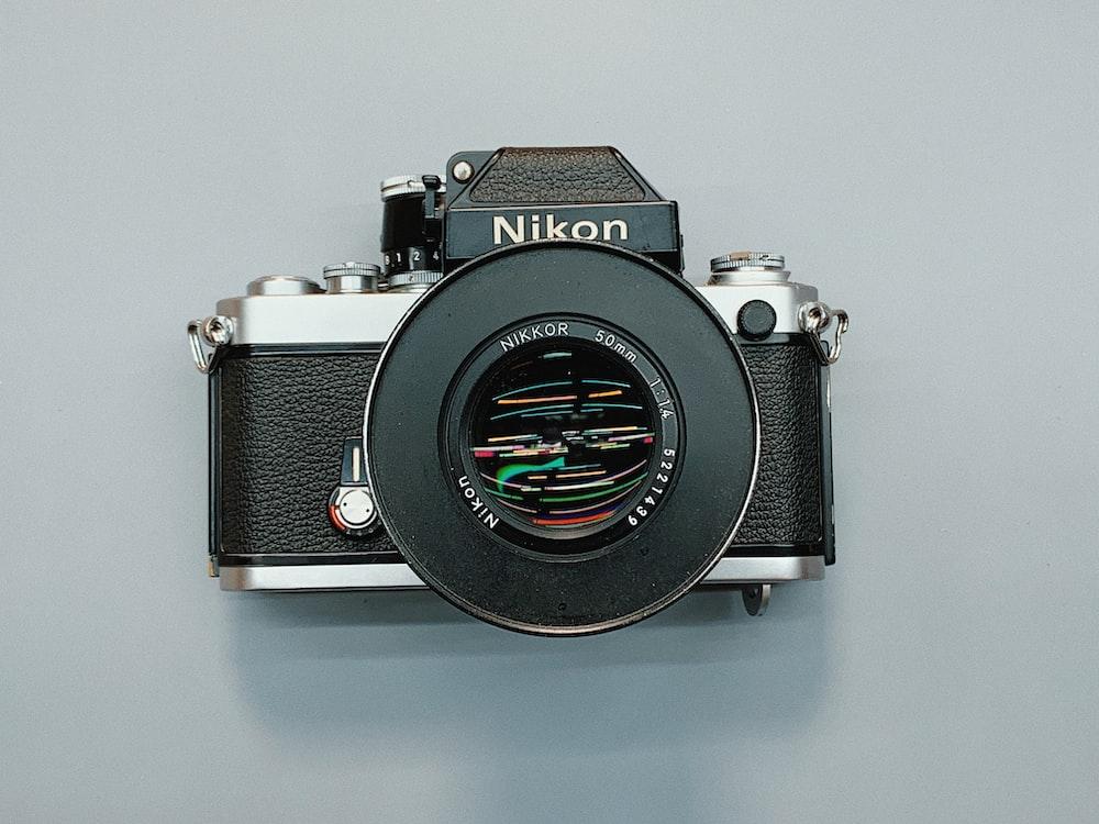 black and grey Nikon DSLR camera