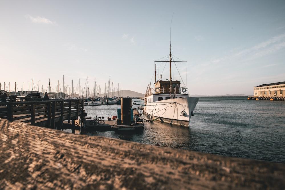 white ship near dock