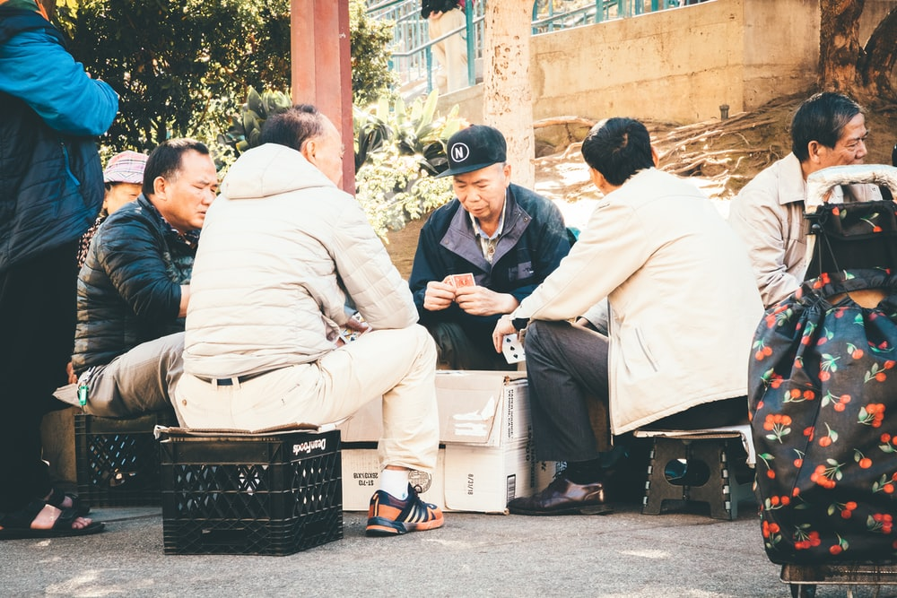 four man sitting on the chair