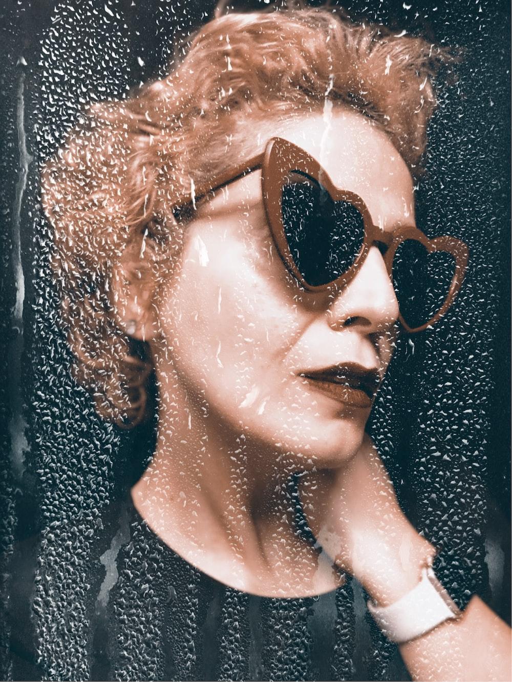 woman wearing brown frame sunglasses inside well lit room