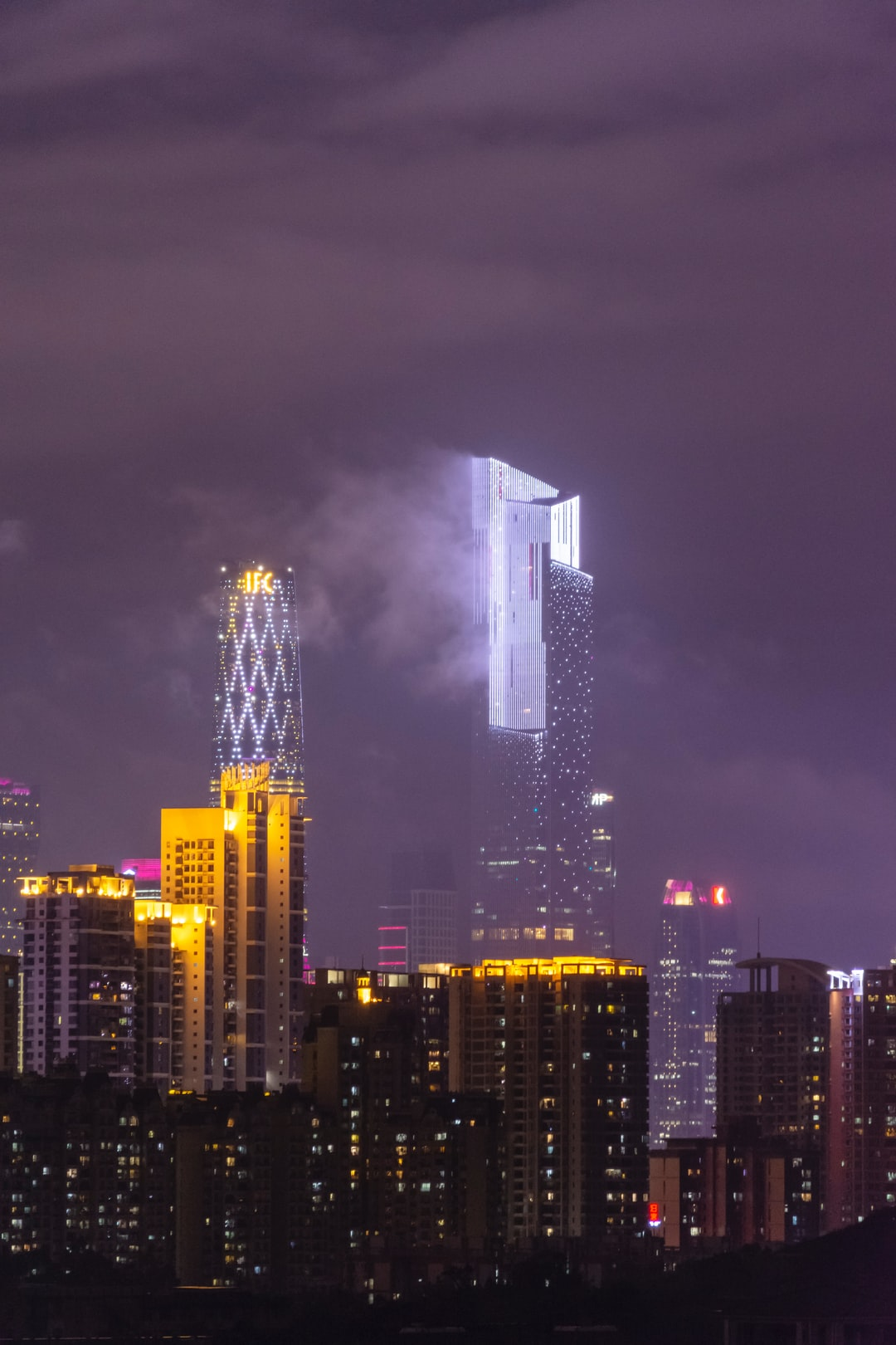 IFC (The West Tower) and Chow Tai Fuk Centre (The East Tower) on a night after shower. The East Tower looked like a smoking crystal that shone brightly in the dark.