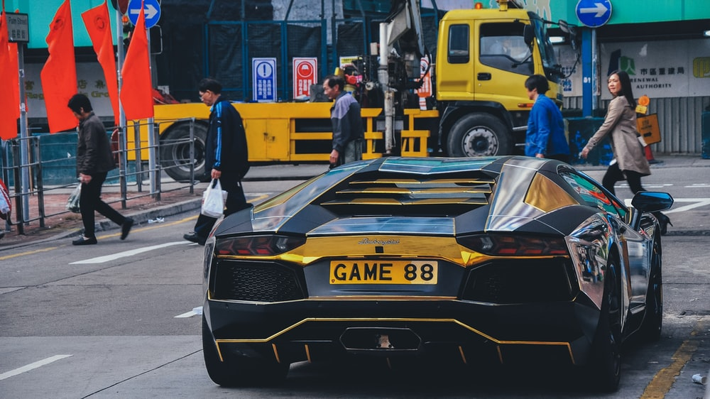 black and yellow sports car on road