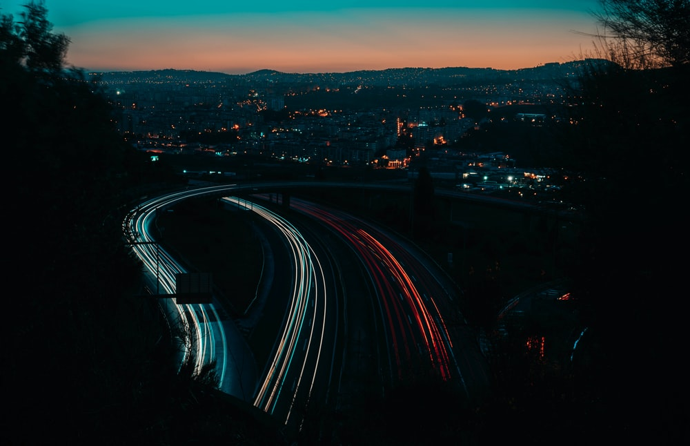 time lapse photography of vehicles passing on roads