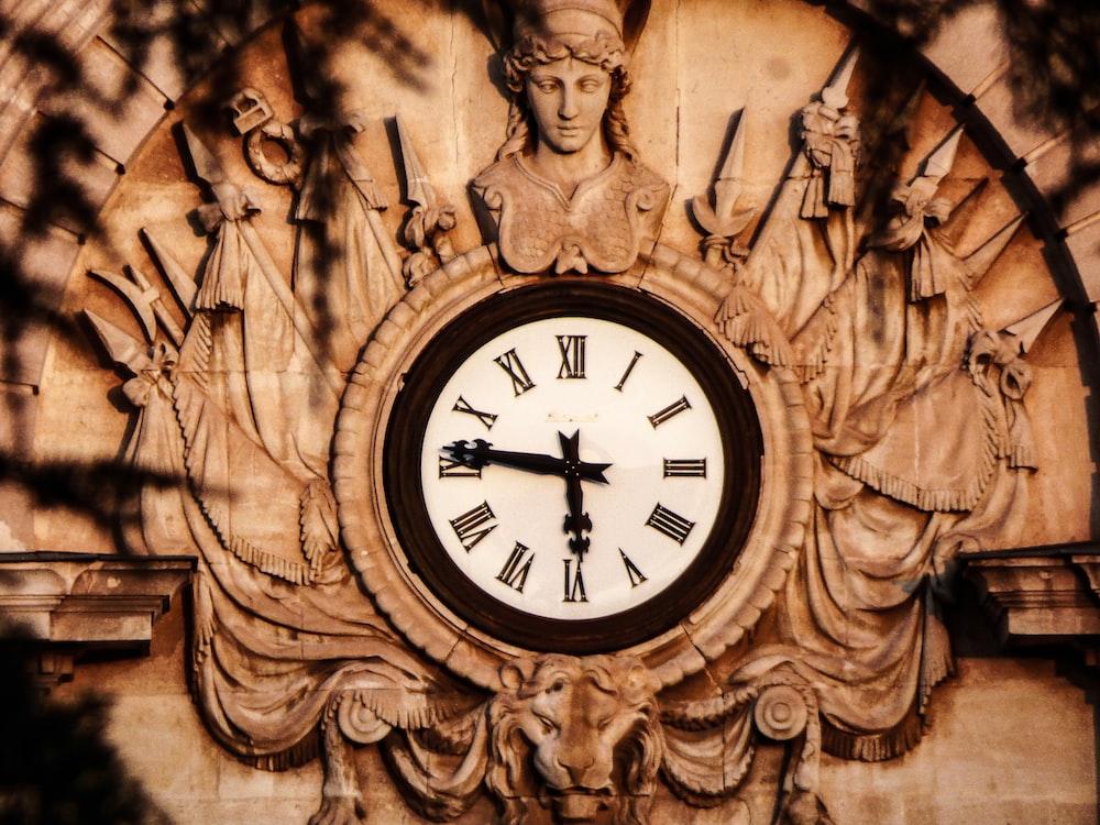roman analog clock displaying at 5:46