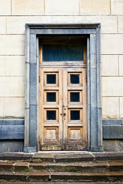 white concrete building showing closed door