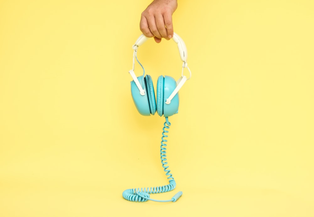 white and blue corded earmuffs