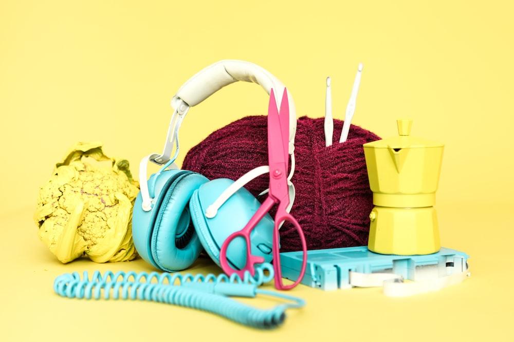 blue earmuffs and red yarn