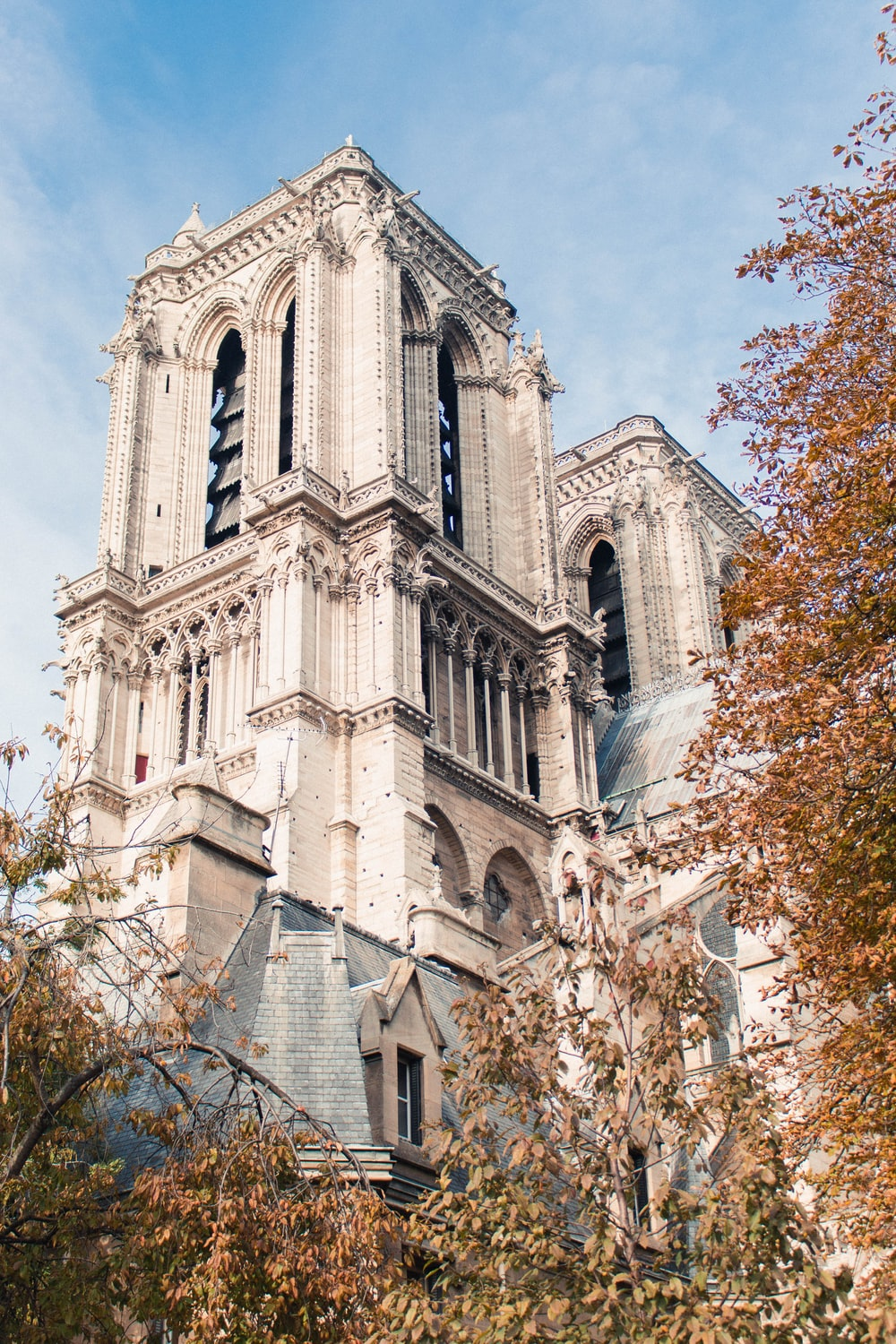 Notre Dame in Paris under blue and white skies