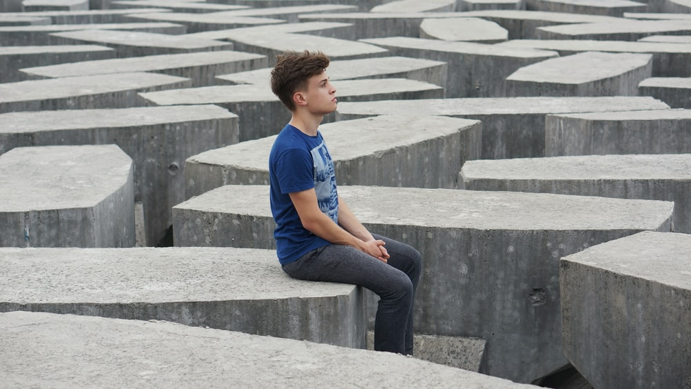 man sitting on rock formations
