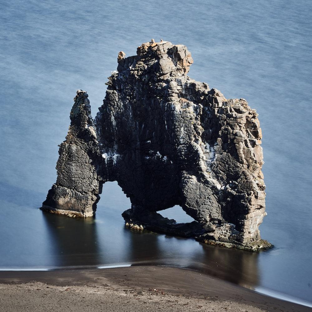 aerial photo of rock formation near seashore