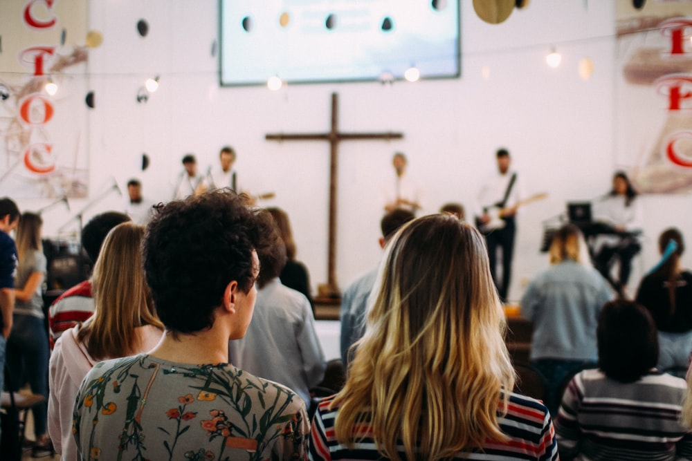 shallow focus photo of people in church