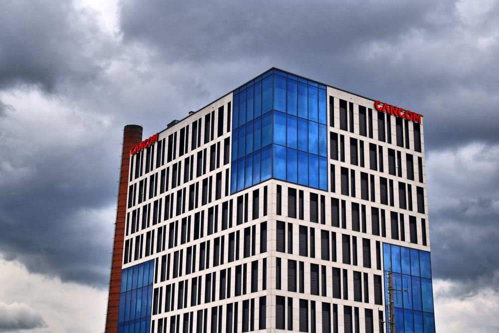 gray and blue concrete building under cloudy sky