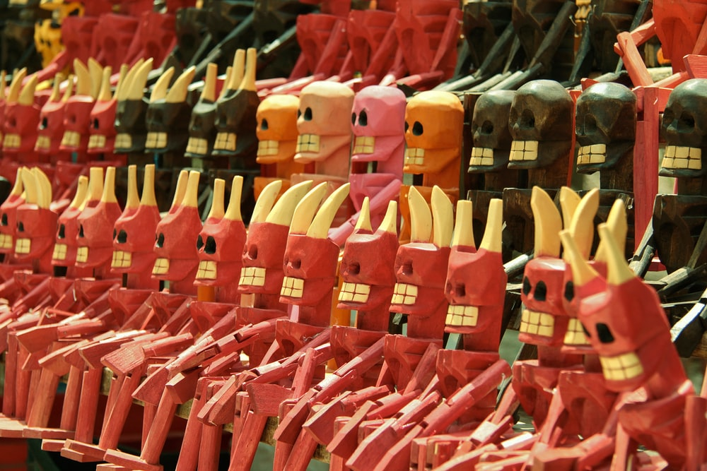assorted-color skull wooden figurine lot