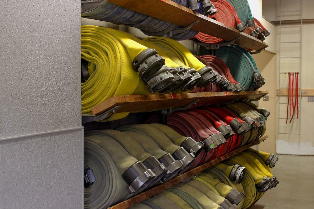 assorted rubber hose lot on rack